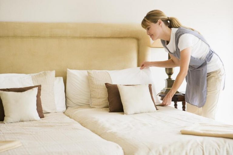 woman fixing the bed
